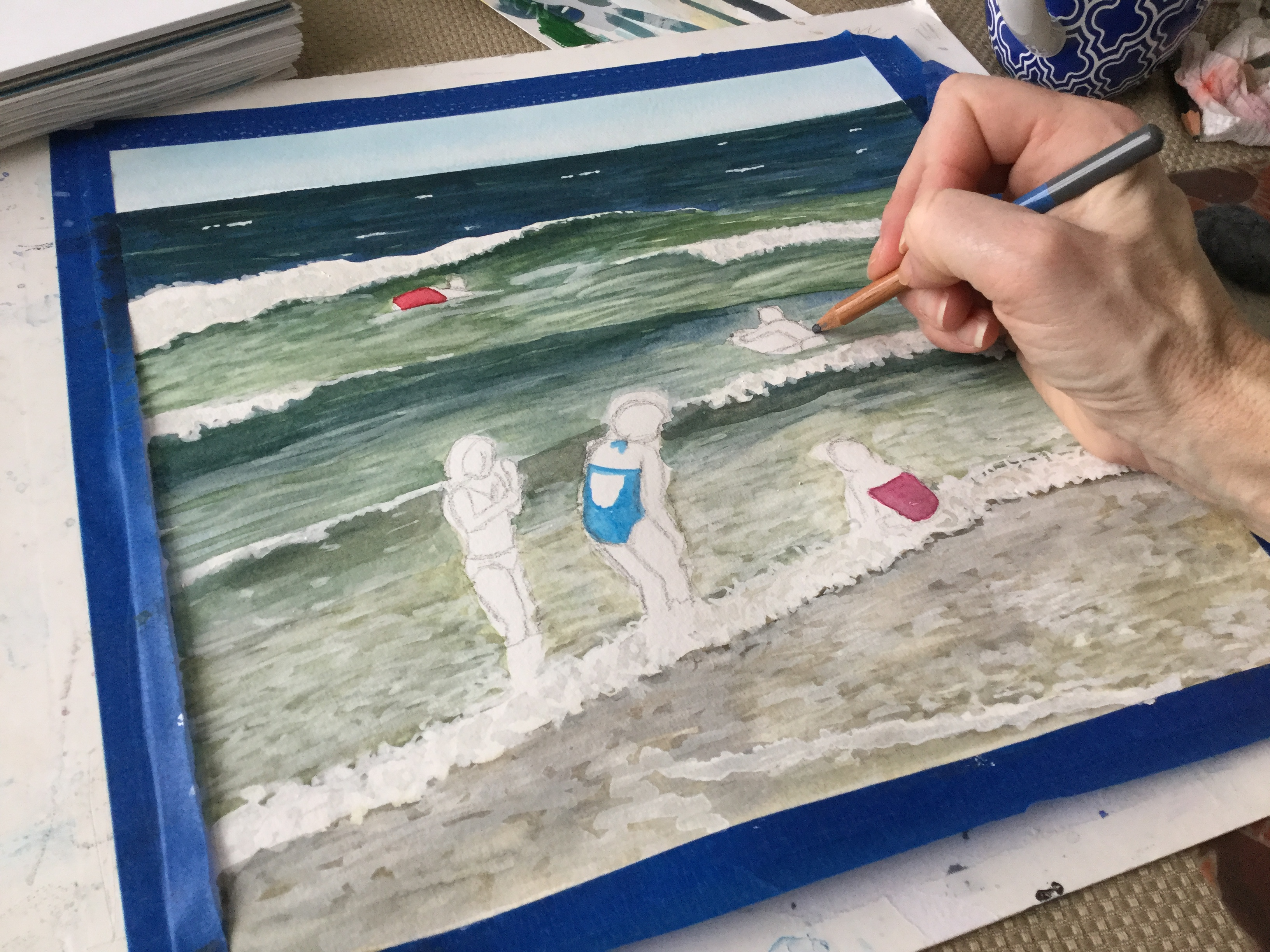 Painting figures on the beach