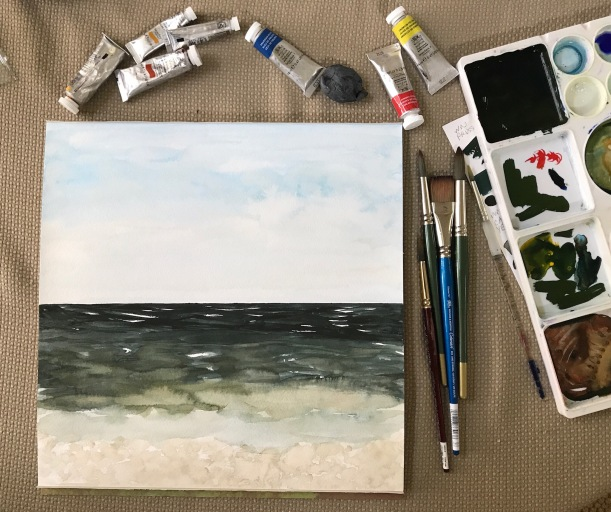 Mixing watercolor paint to paint the ocean